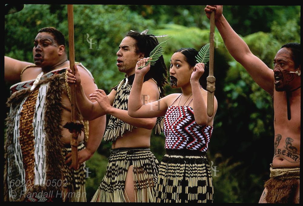 Maori men and women perform traditional greeting song and dance at Waimangu Volcanic Valley; Rotorua, New Zealand.