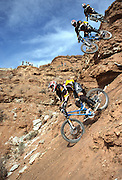 Lance Canfield hucks off of a huge cliff at the 2002 Red Bull Rampage in Virgin, Utah.