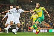 Norwich City forward Teemu Pukki (22) gets in a shot during the EFL Sky Bet Championship match between Norwich City and Swansea City at Carrow Road, Norwich, England on 8 March 2019.