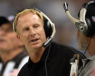 New Orleans head coach Jim Haslett (L)during game action against St. Louis at the Edward Jones Dome in St. Louis, Missouri, October 23, 2005.  The Rams beat the Saints 28-17.