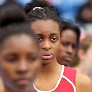 High School relay competitors watch their team mates as they wait for the baton change during competition at the 2013 NYC Mayor's Cup Outdoor Track and Field Championships at Icahn Stadium, Randall's Island, New York USA.13th April 2013 Photo Tim Clayton