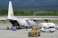 A First Air C-130 Hercules unloads at Whitehorse International Airport.