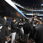 NEW YORK, NEW YORK - APRIL 12: On a bitterly cold evening in New York, Miami Marlins players wear head mask for warmth in the dugout before batting during the Miami Marlins Vs New York Mets MLB regular season ball game at Citi Field on April 12, 2016 in New York City. (Photo by Tim Clayton/Corbis via Getty Images)