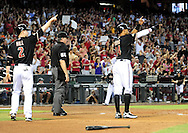 Sep. 24 2011; Phoenix, AZ, USA; Arizona Diamondbacks infielder Aaron Hill (2) and teammate outfielder .Chris Young (24) congratulate infielder Ryan Roberts (not pictured) after scoring during the first inning against the San Francisco Giants at Chase Field. Mandatory Credit: Jennifer Stewart-US PRESSWIRE