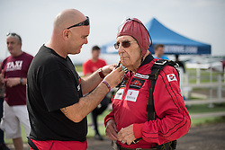 © Licensed to London News Pictures. 25/08/2016. <br /> <br /> Pictured: D-Day veteran Ted Pieri prepares for his jump.<br /> <br /> Fred Glover and Ted Pieri, two D-Day veterans who are both 90 years old have parachuted into Sarum Airfield, Wiltshire on Thursday 25th August 2016, 72 years after D-Day having earlier in the month parachuted into Merville Battery in France.<br /> <br /> <br /> Photo credit should read Max Bryan/LNP