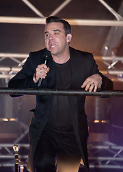 Robbie Williams, during the Marmite Oxford Street Christmas Lights switch-on. Robbie Williams switches on this year's Christmas lights on the London High Street, hosted by House of Fraser with support from Lewis and boyband Lawson. Theakston and Bunton from Heart 106.2 present, Oxford Street, London, United Kingdom., Oxford Street, London, United Kingdom, November 5, 2012. Photo by Nils Jorgensen / i - Images.<br /> File Photo: Robbie Williams expecting second baby. Robbie Williams has said he will not be joining Take That on any future tour after revealing he is to become a father again. Photo filed Wednesday 30th April 2014.