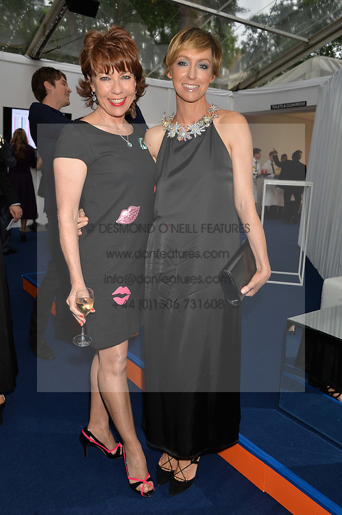 Left to right, KATHY LETTE and JO ELVIN at the Glamour Women of The Year Awards in Association with Next held in Berkeley Square Gardens, Berkeley Square, London on 3rd June 2014.
