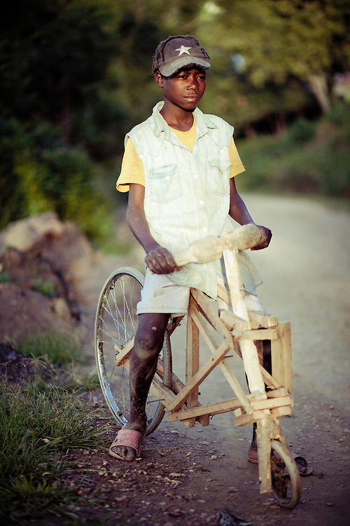 Rukundo Theogen, aged 12, who's home-made wooden bike was one month old