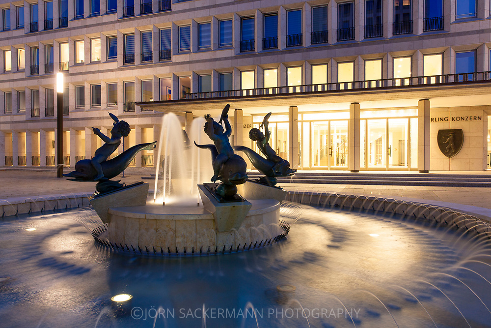 the Gerling Quartier, fountain with four boys riding on dolphins by artist Arno Breker at the Gereonshof, Cologne, Germany.<br /> <br /> das Gerling Quartier, Brunnen mit vier Knaben, die auf Delphinen reiten von Kuenstler Arno Breker, Gereonshof, Koeln, Deutschland.