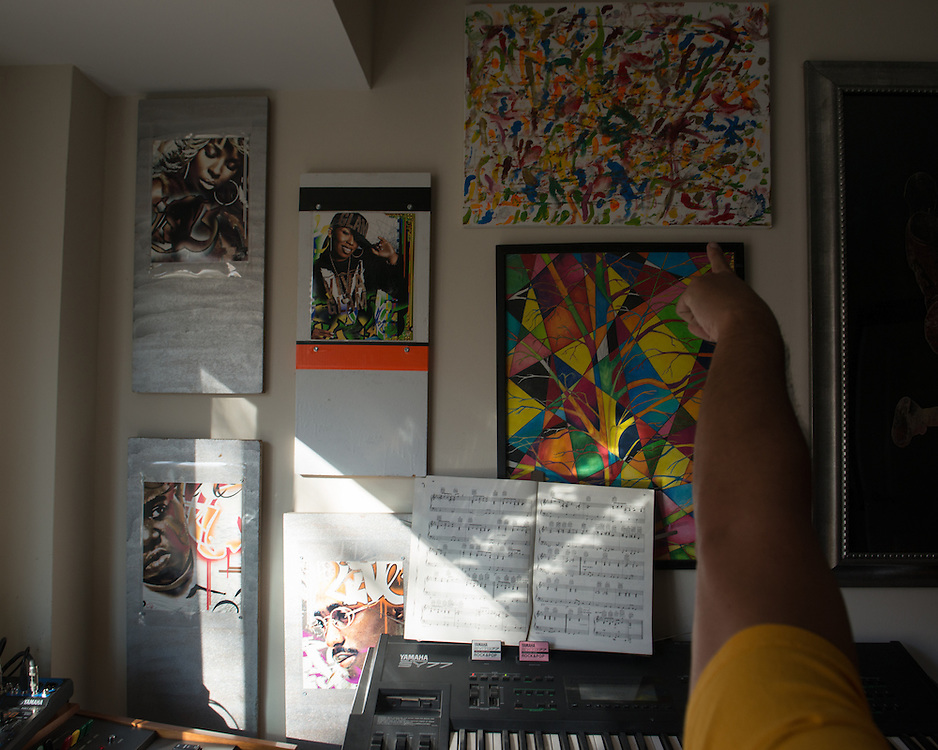 December 5, 2015 - Fairfax, VA - A day in the life of &quot;Doc Nix,&quot; aka Dr. Michael Nickens, the Director of the Athletic Bands for George Mason University. Artwork on the walls in his apartment was made by former students illustrating musical compositions and a close friend from high school.<br /> <br /> Photo by Susana Raab