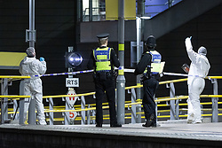 © Licensed to London News Pictures . 01/01/2019 . Manchester, UK. Crime Scene Investigators work at the scene on Metrolink platform B at Victoria Station . Police have closed off Victoria Station in Manchester after several people were stabbed , including a British Transport Police officer , in a knife attack last night (Monday 31st December 2018). A man was arrested after a taser was deployed at the scene . Photo credit: Joel Goodman/LNP
