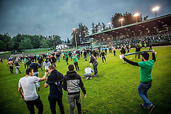 Supporters of Olimpija celebrate after winning during football match between NK Rudar and NK Olimpija Ljubljana in Round #35 of Prva liga Telekom Slovenije 2015/16, on May 14, 2016, in Stadium Ob jezeru, Velenje, Slovenia. NK Olimpija with this victory became Slovenian National Champion 2016. Photo by Vid Ponikvar / Sportida