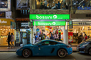 A light blue Porsche parked outside a Bossini outlet store on Lockhart Road, Causeway Bay, Hong Kong. <br /> (photo by Andrew Aitchison / In pictures via Getty Images)