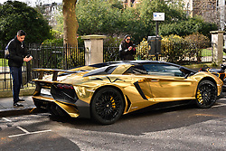 © Licensed to London News Pictures. 31/03/2016. London, UK. A fleet of supercars including a £350,000 Lamborghini Aventador SV is covered in gold chrome wrap parked in Knightsbridge, London on Wednesday, 31 March 2016. Cars are believed to be owned by Saudi billionaire Turki Bin Abdullah .Photo credit: Ray Tang/LNP