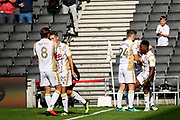 MKDons forward Kieran Agard (14) celebrates his goal with team mates during the EFL Sky Bet League 2 match between Milton Keynes Dons and Exeter City at stadium:mk, Milton Keynes, England on 25 August 2018.