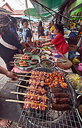 Laos. Luang Prabang. Morning market. Grilled meat and sausages.