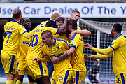 AFC Wimbledon attacker Marcus Forss (15), AFC Wimbledon striker Joe Pigott (39), AFC Wimbledon defender Ryan Delaney (21) celebrate goal during the EFL Sky Bet League 1 match between Southend United and AFC Wimbledon at Roots Hall, Southend, England on 12 October 2019.