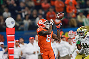 Clemson Tigers wide receiver Justyn Ross (8) catches a deep pass from quarterback Trevor Lawrence (16) during the game of the NCAA Cotton Bowl semi-final playoff football game against the Notre Dame Fighting Irish, Saturday, Dec. 29, 2018, in Arlington, Texas. Clemson defeated Notre Dame 30-3 to advance to the College Football Playoff national Championship. (Mario Terrana/Image of Sport via AP)