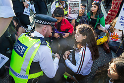 London, UK. 20 September, 2019. Metropolitan Police officers issue warnings under s14 of the Public Order Act 1986 to students blocking Lambeth Bridge during the second Global Climate Strike in protest against a lack of urgent action by the UK Government to combat the global climate crisis. The Global Climate Strike grew out of the Fridays for Future movement and is organised in the UK by the UK Student Climate Network.