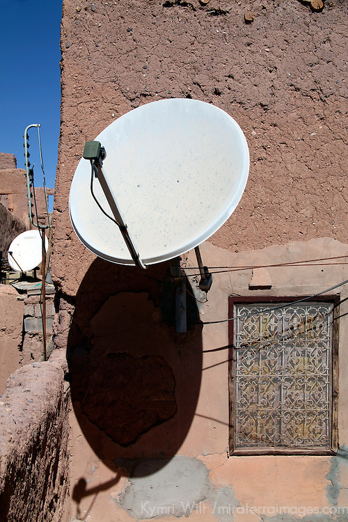 Africa, Morocco, Ouarzazate. Satellite Dish portrudes from walls of Berber village.