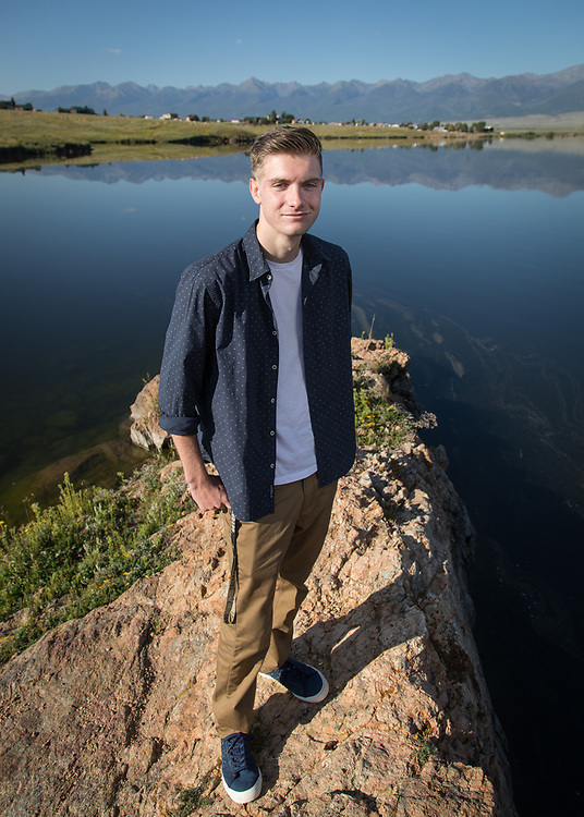 Michael Milisavljevich poses for his senior portrait at Lake DeWeese.