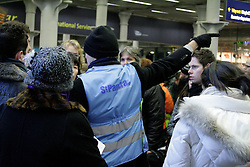 © London News Pictures. 2010.12.20.  St Pancras International EuroStar, thousands of travellers queue for hours in the bitter cold with the hope of getting on a train in the Christmas getaway, 20/10/2010. ..Eurostar closed their St Pancras office, no booking being taken until 24/12/2010. Staff advise passengers not to turn up to the station without a ticket for a confirmed running train. Picture caption should read Simon Lamrock/LNP