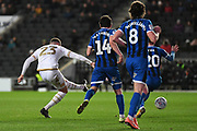 Milton Keynes Dons forward (on loan from Norwich) Carlton Morris (23) takes a shot at goal during the EFL Sky Bet League 1 match between Milton Keynes Dons and Rochdale at stadium:mk, Milton Keynes, England on 28 January 2020.