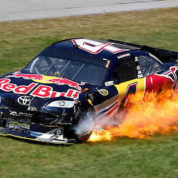 April 17, 2011; Talladega, AL, USA; NASCAR Sprint Cup Series driver Kasey Kahne (4) glides through the grass as he catches fire during the Aarons 499 at Talladega Superspeedway.   Mandatory Credit: Derick E. Hingle