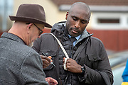 Macclesfield Town as he arrives and stops to sign an autograph during the EFL Sky Bet League 2 match between Grimsby Town FC and Macclesfield Town at Blundell Park, Grimsby, United Kingdom on 12 January 2019.