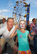 12/12/2012 Luna Park 100th Birthday celebrations. James Tomkins &amp; daughter Goergia 7 yrs.Photo By Craig Sillitoe This photograph can be used for non commercial uses with attribution. Credit: Craig Sillitoe Photography / http://www.csillitoe.com<br />