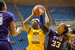 West Virginia Mountaineers forward Crystal Leary (32) grabs a rebound over TCU Horned Frogs guard Donielle Breaux (33) at the WVU Coliseum.