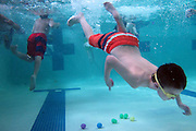 Dexter Klein (8) dives for Easter eggs during the Under the Sea Adventure at the Don Rodenbaugh Natatorium in Allen on Saturday, March 30, 2013. (Cooper Neill/The Dallas Morning News)