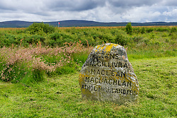 Memorial Headstone of a Clan on natural moorland at Culloden Moor former battlefield in Highland, Scotland