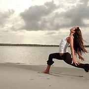 Yoga instructor Tara Folton on the beach.
