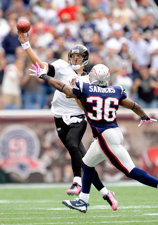 FOXBORO, MA - OCTOBER 04: Joe Flacco #5  the Baltimore Ravens passes as James Sanders #36 of the New England Patriots defends at Gillette Stadium on October 4, 2009 in Foxboro, Massachusetts. The Patriots defeated the Ravens 27 to 21. (Photo by Rob Tringali) *** Local Caption *** Joe Flacco;James Sanders