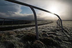 © Licensed to London News Pictures. 22/03/2014<br /> <br /> Middleham, North Yorkshire<br /> <br /> First light on the horse racing gallops in Middleham, North Yorkshire. Race horses have been trained in Middleham for over 200 years using the extensive gallops on the high moor. There are currently 15 stables based around the small Yorkshire village.<br /> <br /> Photo credit : Ian Forsyth/LNP