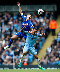 Marc Albrighton of Leicester City challenges for a header with Gabriel Jesus of Manchester City - Mandatory by-line: Matt McNulty/JMP - 13/05/2017 - FOOTBALL - Etihad Stadium - Manchester, England - Manchester City v Leicester City - Premier League