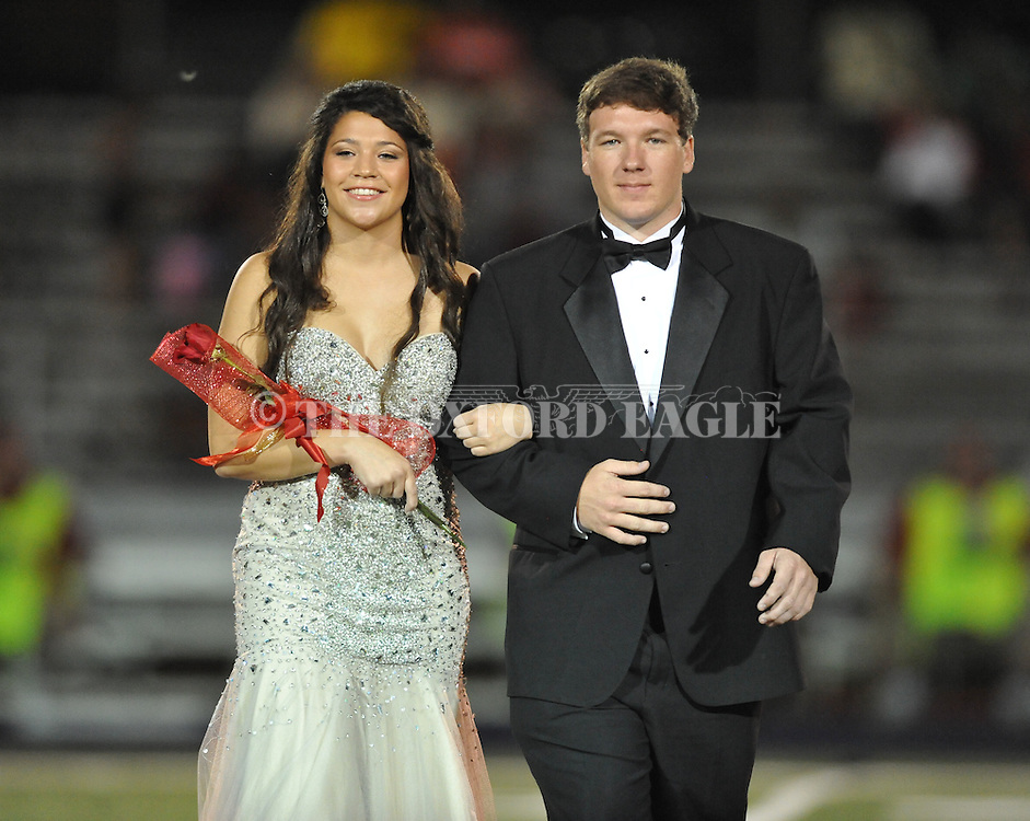 Senior maid Emily Boatright is escorted by Matthew Norwood during Homecoming at Lafayette High vs. Shannon in Oxford, Miss. on Friday, September 19, 2014. Lafayette High won 35-0 to improve to 2-3 on the season.
