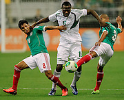 May 31, 2013; Houston, TX, USA; Nigeria forward Obinna Nwachukwu (15) tries to dribble between Mexico defender Carlos Salcido (3) and midfielder Angel Reyna (8) during the second half at Reliant Stadium. Nigeria and Mexico played to a 2-2 draw. Mandatory Credit: Thomas Campbell-USA TODAY Sports