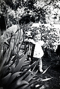 mother posing with toddler in garden France 1900s