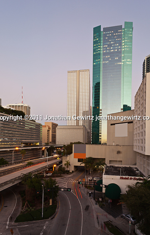 Twilight view of Miami's downtown commercial and hotel district, Knight Center, expressway ramps to US Route 95 and Metromover elevated rail tracks. WATERMARKS WILL NOT APPEAR ON PRINTS OR LICENSED IMAGES.