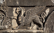 Carved relief depicting a griffin on a capital from the fringed pilasters of the Temple of Apollo, 4th century BC, Didyma, Aydin, Turkey. A griffin is a mythological creature which is half lion, half eagle and these were the guardians of the sanctuary. Didyma was an ancient Greek sanctuary on the coast of Ionia near Miletus, consisting of a temple complex and the oracle of Apollo, or Didymaion, who was visited by pilgrims from across the Greek world. The earliest temple ruins found here date to the 8th century BC but Didyma's heyday lasted throughout the Hellenistic age. It was approached along a 17km Sacred Way from Miletus and is the largest sanctuary in Western Turkey. Picture by Manuel Cohen