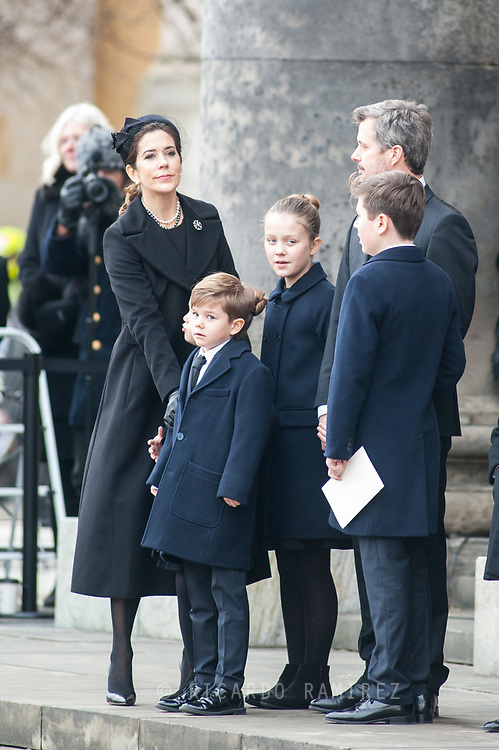 20.02.2018. Copenhagen, Denmark. <br /> Crown Princess Mary,  Crown Prince Frederik, Princess Josephine, Prince Vincent, Prince Christian and Princess Isabella on the steps of the church, looking on as the car carrying Prince Henrik departs following the service.<br /> Photo: Ricardo Ramirez.