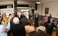 BEDC Vice Chair Randy Eifert and Mayor Ed Engler address the crowd gathered at Wayfarer Coffee Roasters to make the official announcement for the purchase of the Colonial Theater on Main Street downtown Laconia.  (Karen Bobotas/for the Laconia Daily Sun)