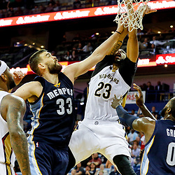 Mar 21, 2017; New Orleans, LA, USA; New Orleans Pelicans forward Anthony Davis (23) dunks over Memphis Grizzlies center Marc Gasol (33) during the second half of a game at the Smoothie King Center. The Pelicans defeated the Grizzlies 95-82. Mandatory Credit: Derick E. Hingle-USA TODAY Sports
