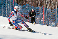Gate judge Maggie Doherty observes Tanner Visnick of Steamboat Springs, CO as he competes in the Classic course during Friday's US Telemark Championships at Gunstock Mountain Resort.   (Karen Bobotas/for the Laconia Daily Sun)