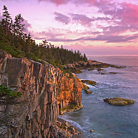 Scenic Coastal Maine seascape photography at sunset featuring a spectacular view across the beautiful cliffs at Raven's Nest along the Acadia National Park coastal shoreline of Schoodic Peninsula. This coastal spot is secretly tucked away in the much less crowded portion of the national park. The area is dramatic and unmarked an unpromoted by the park for obviously reasons. I finally made a return journey to the only area of the national park that is located on main land. With tripod and camera positioned at the edge of the steep Ravens Nest cliffs in front of me and one wrong step away from going down into the ocean I captured Sunset at Raven's Nest.<br />