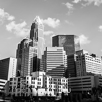 Black and white panorama photo of Charlotte skyline with clouds. Panorama photo ratio is 1:3.  Includes One Wells Fargo Center, Two Wells Fargo Center, Bank of America Corporate Center, Bank of America Plaza, 121 West Trade building, and Carillon Tower. Charlotte, North Carolina is a major city in the Eastern United States of America