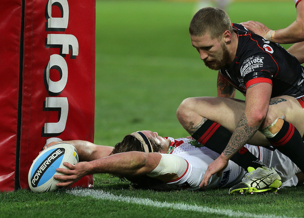 Mitch Rein of the Dragons scores a try beating Sam Tomkins of the New Zealand Warriors to the line during their round 22 NRL match at Westpac  Stadium, Wellington on  Saturday, August 08, 2015. Credit: SNPA / David Rowland