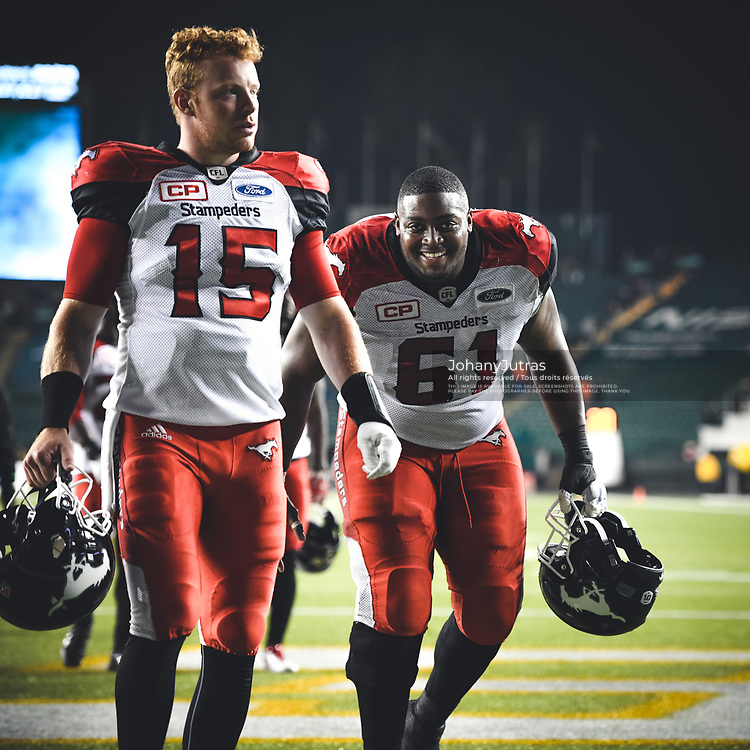 Ucambre Williams (61) and Andrew Buckley (15) of the Calgary Stampeders after the game against the Edmonton Eskimos at Commonwealth Stadium in Edmonton AB, Saturday, September 9, 2017. (Photo: Johany Jutras)